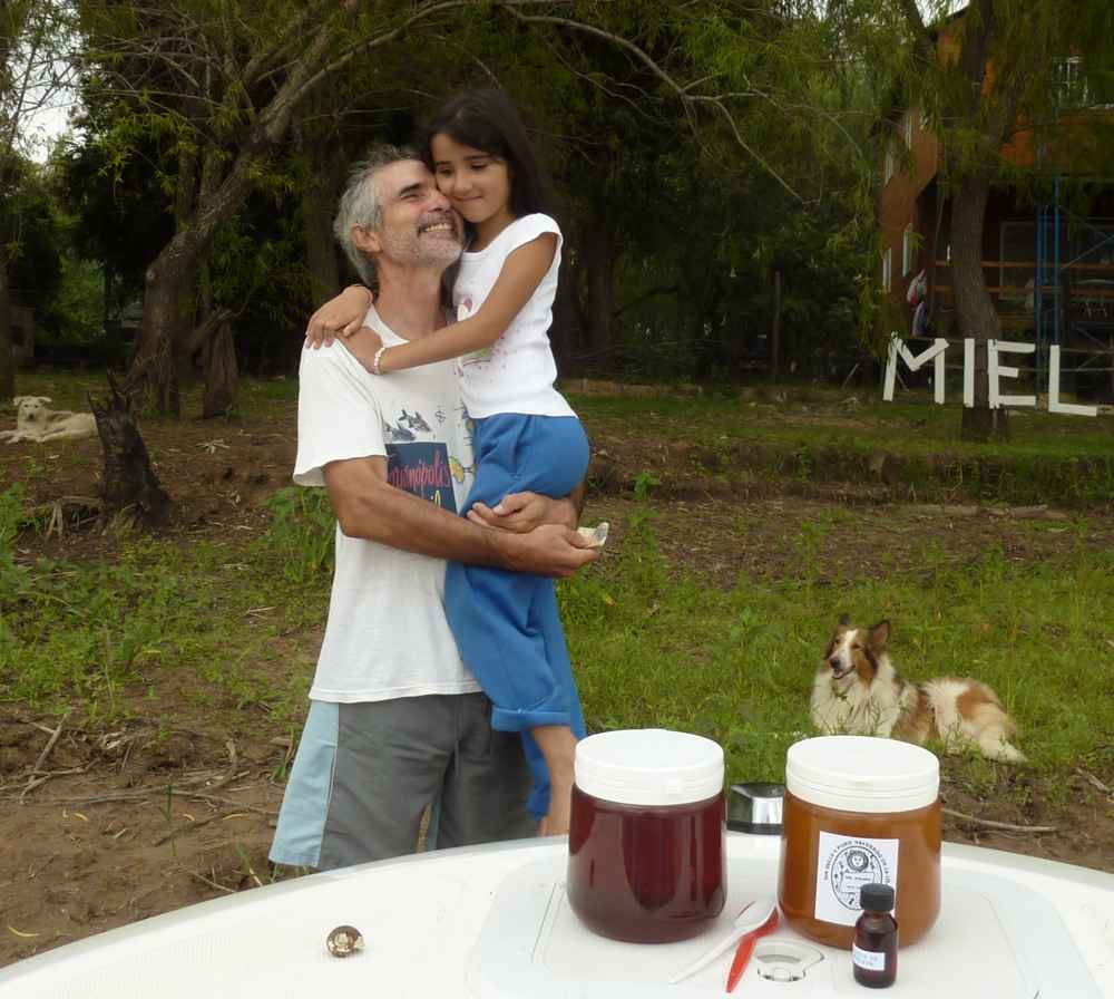 Luis and his daughter pose with the honey